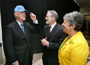 Bill Clinton dons a UCLA hat while Abrams and Mary Nichols look on